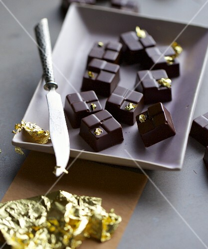 Honey and poppyseed pralines with gold leaf
