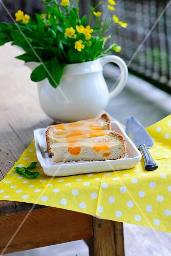 Sour cream cake with apricots on a balcony table