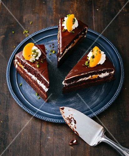 Three slices of gluten-free peach and chocolate cake