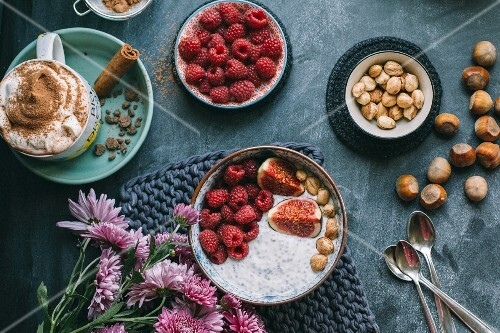 Hot chocolate and muesli with raspberries, figs and nuts