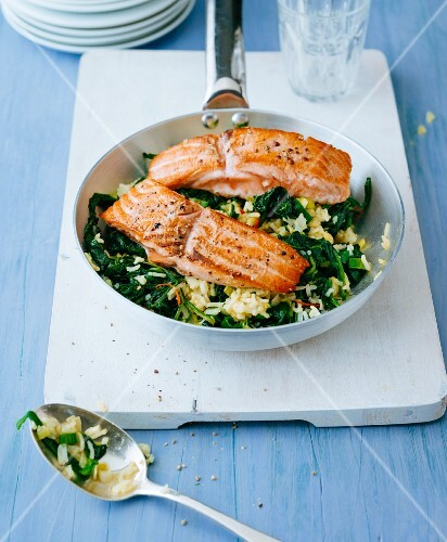 Fried rice with spinach and fried salmon