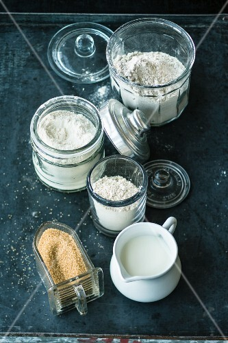 Various types of flour, milk and brown sugar for baking bread