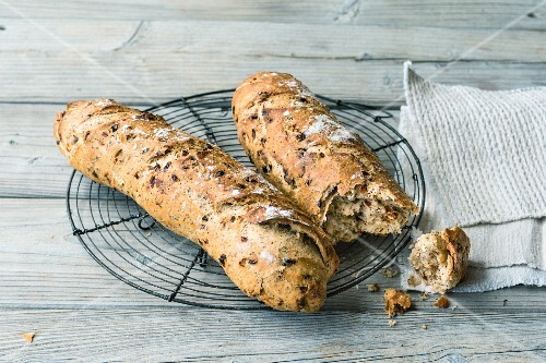 Tomato and poppyseed baguettes made from sour dough