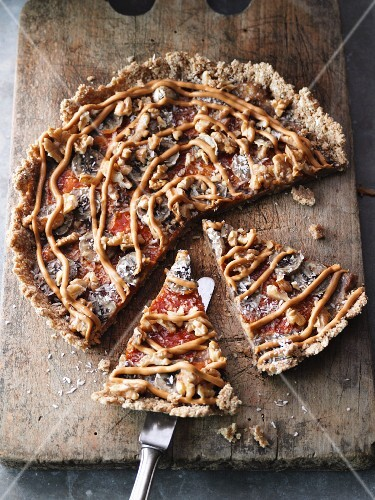 A sweet breakfast pizza with apple sauce, bananas and peanut butter