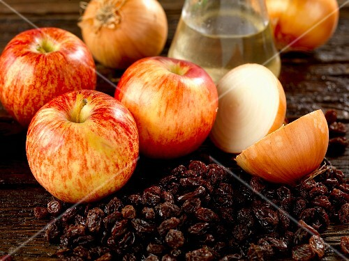 Ingredients for making chutney with apples, raisins, onions and white wine vinegar
