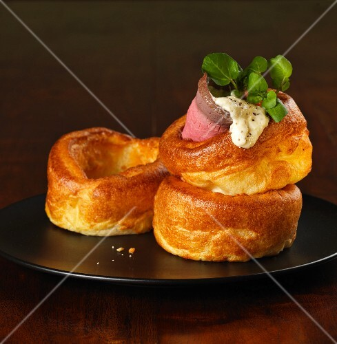 Yorkshire puddings with a slice of roast beef, horseradish and watercress