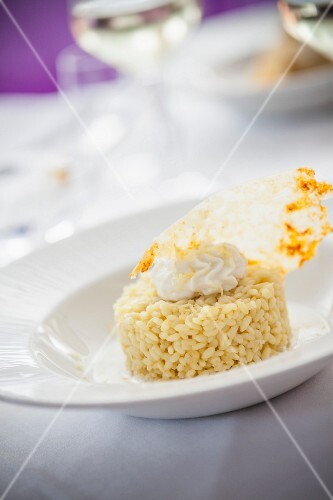 Saffron rice with Parmesan cream and Parmesan crisps