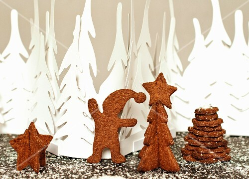 Gingerbread figures against a white winter forest