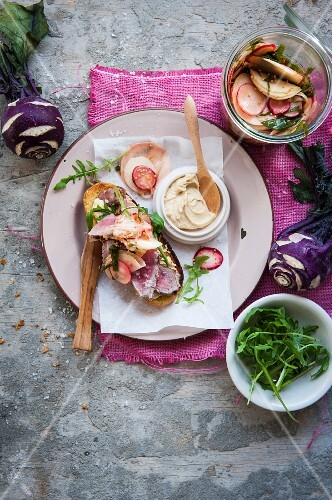 A steak sandwich with pickled kohlrabi and radishes