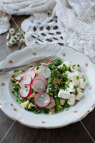 Millet salad with asparagus, goat's cheese, radishes and chives