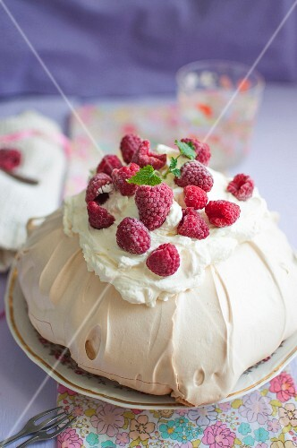 Pavlova (meringue cake) with mascarpone cream and fresh raspberries