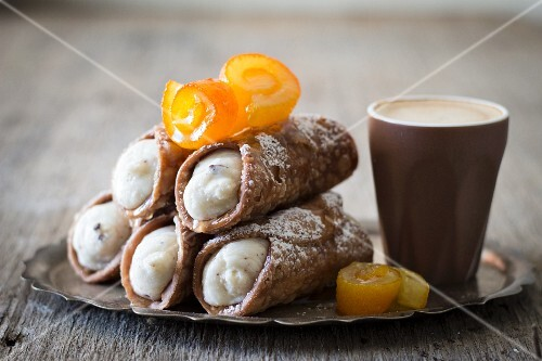 Cannoli with candied oranges served with coffee