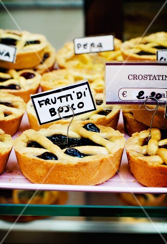 Frutti di bosco (forest fruits) tartlets on display in an Italian bakery