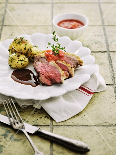 Duck breast with herb potatoes