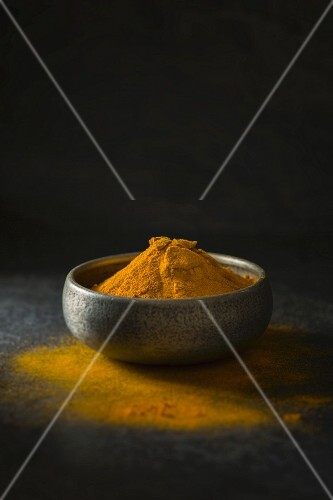 Ground turmeric in a dish