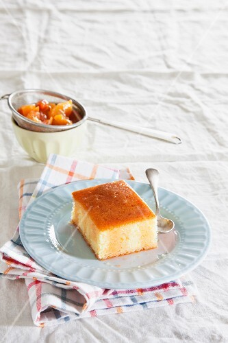 A slice of semolina cake with summer fruit syrup