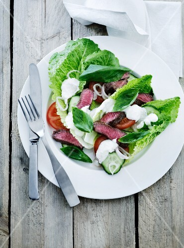 Salad with tomatoes, cucumber, mozzarella and beef steak