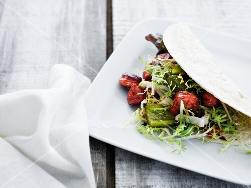 Salad with chorizo and avocado in a tortilla