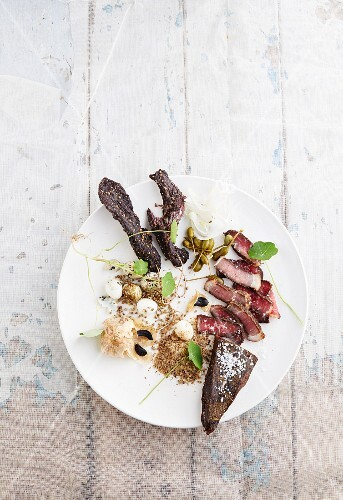 Biltong with black garlic, fennel, quail's eggs and capers (South Africa)