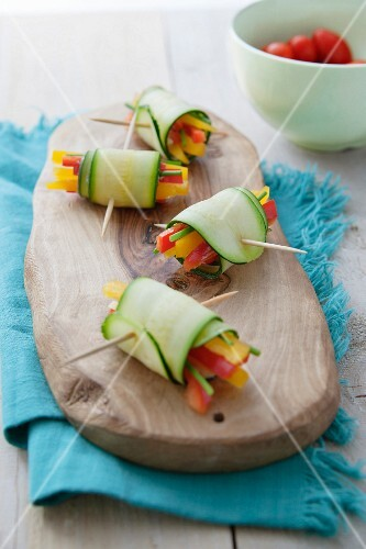 Courgette rolls filled with coloured peppers and chives