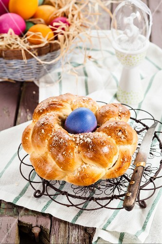 A traditional Easter nest bread with an Easter egg