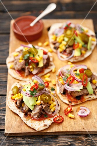 Homemade tortillas with pork, avocado, sweetcorn, red onions and chilli peppers