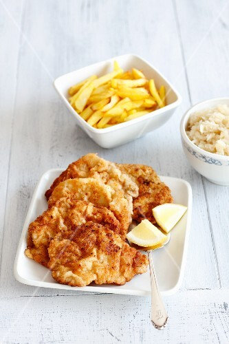 Pork escalopes with chips and steamed cabbage