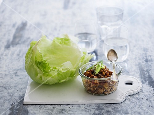 Iceberg lettuce with a minced meat and vegetable sauce