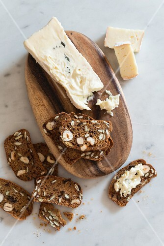 Fruit bread with nuts and soft cheese