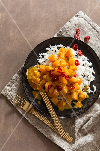 Pumpkin curry with chilli peppers and rice