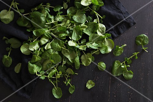 Fresh watercress on a wooden surface