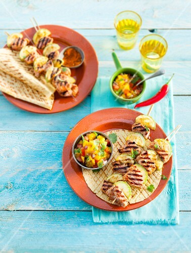 Grilled pork skewers with mango salsa (Mexico)