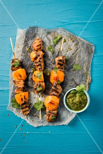 Grilled skewers with duck breast and persimmons