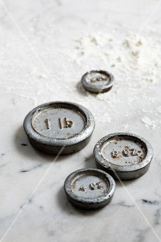 Weights on a floured marble surface
