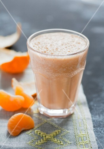 A smoothie with banana, carrots and mandarins