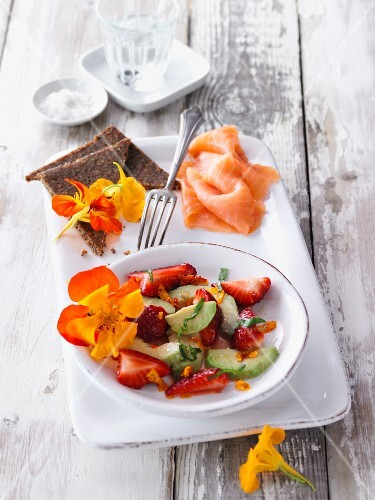 Vegan avocado and strawberry salad with nasturtiums