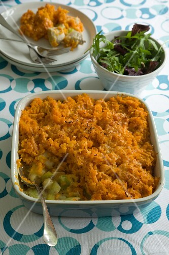 Chicken and leek pie topped with mashed sweet potatoes