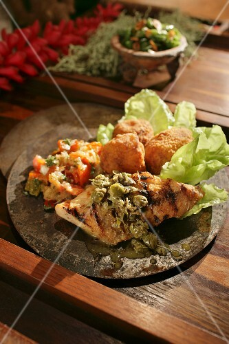 Mahi fish grilled with a caper sauce and croquettes