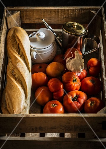 Ingredients for gazpacho in a wooden crate