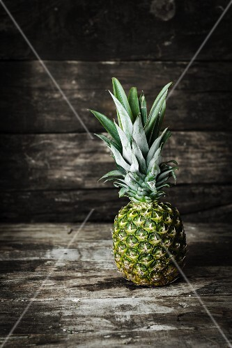 A pineapple on a wooden surface