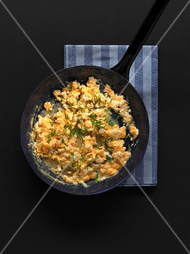 Scrambled egg in a rustic pan