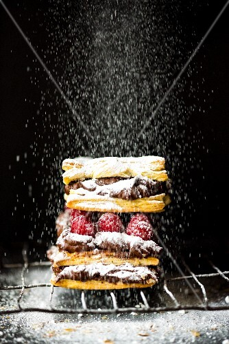 Mille feuilles with chocolate cream, raspberries and icing sugar