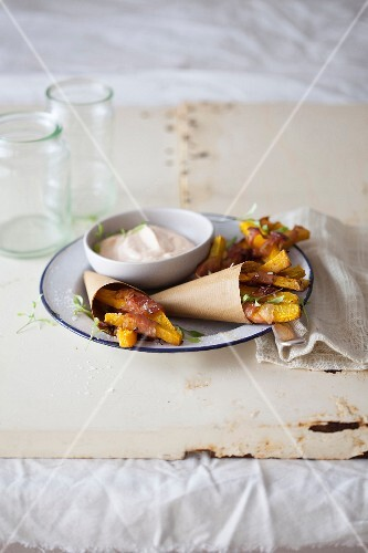 Pumpkin chips in bacon with a pepper dip