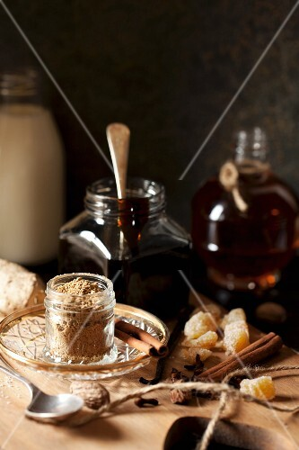 Ingredients for making gingerbread cream liqueur on a wooden board
