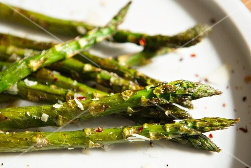 Fried asparagus with Parmesan cheese and chilli flakes
