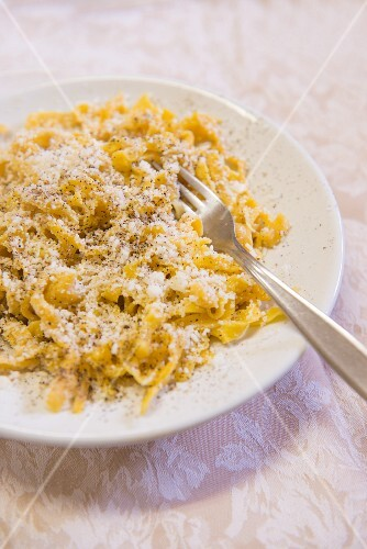 Pasta with cheese and ground black pepper
