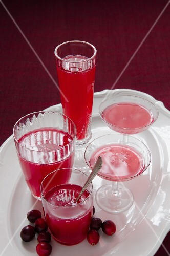 Homemade cranberry jelly in various glasses