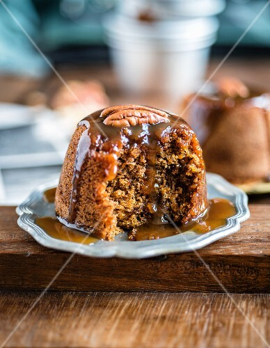 Sticky toffee pudding with dates, ginger and a brandy toffee sauce
