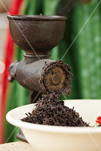 Poppy seeds being ground in a mill