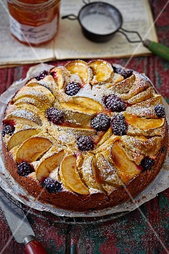 Apple and blackberry cake dusted with icing sugar